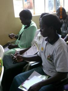 Women farmers testing the SMS application.