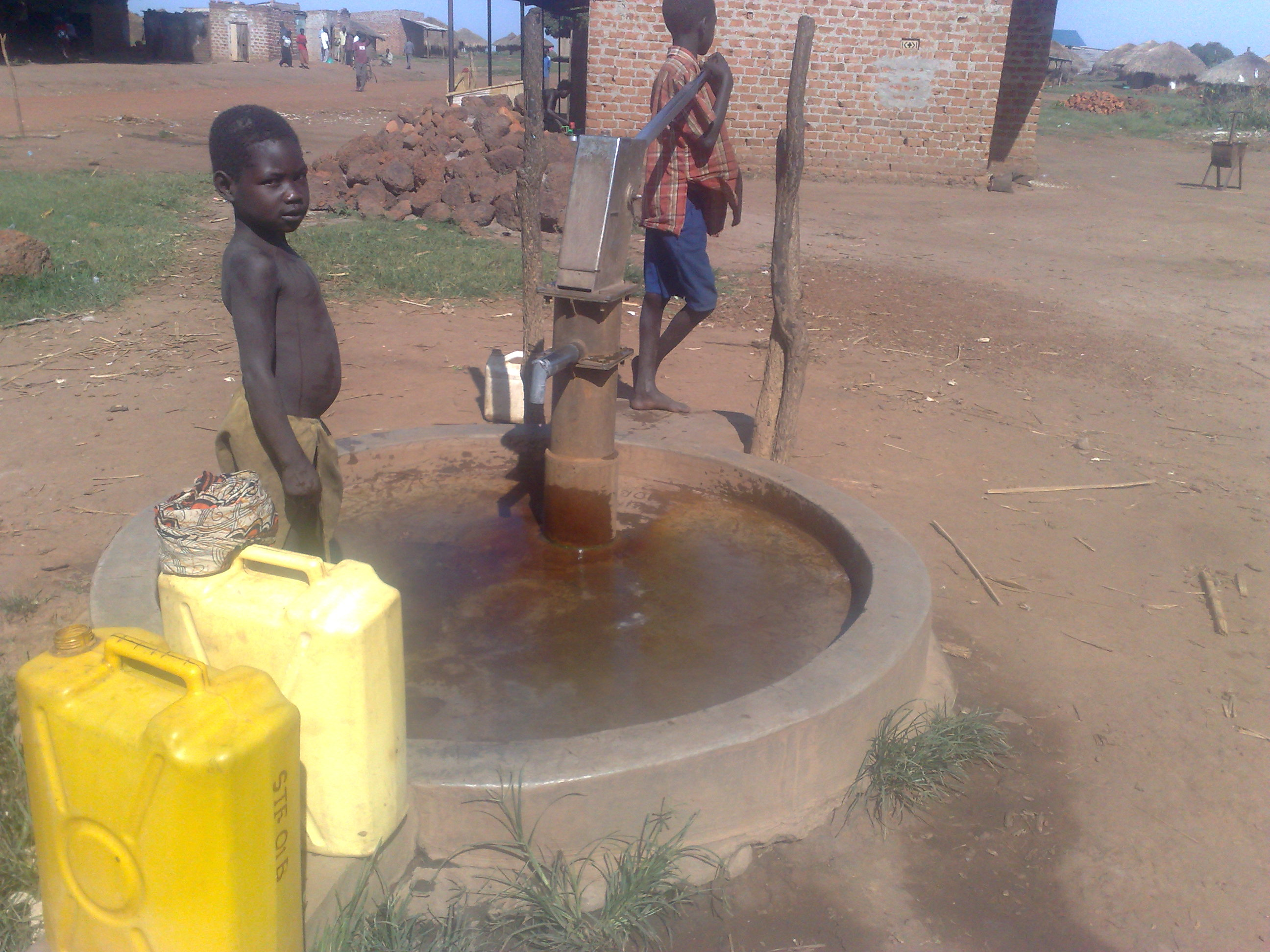 Children collecting water at a bore hole in Amuru district, Northern