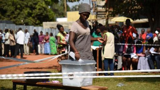 Yahoo Photo. A Ugandan casting a ballot earlier today.